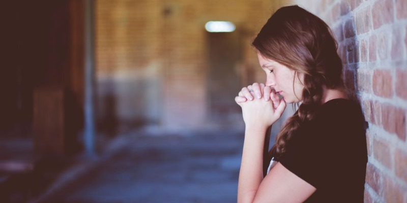 girl hands clasped prayer